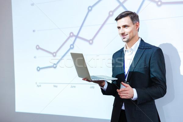 Hangszóró tart laptop bemutató boldog konferencia Stock fotó © deandrobot