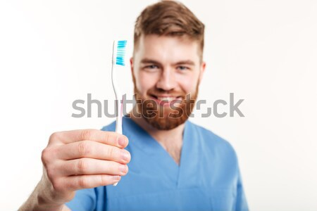 Handsome male dotor holding red pill Stock photo © deandrobot