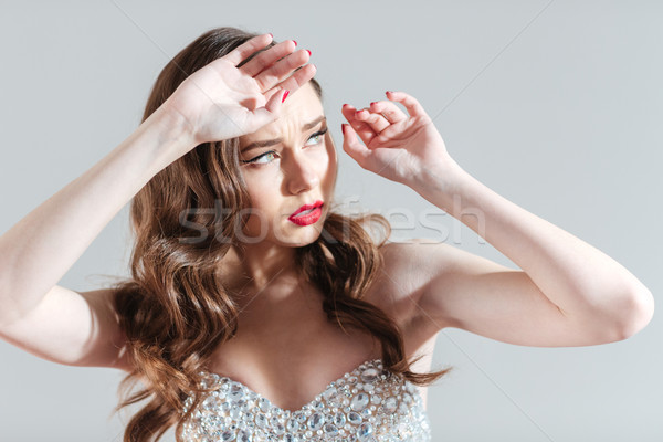 Young woman looking on bright flash Stock photo © deandrobot