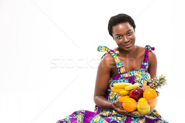 Aantrekkelijk glimlachend afrikaanse vrouw kleurrijk Stockfoto © deandrobot