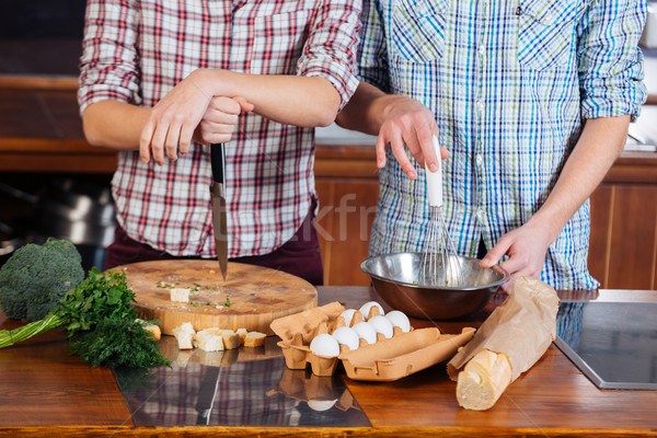 Stock photo: Young couple cooking together on the kitchen