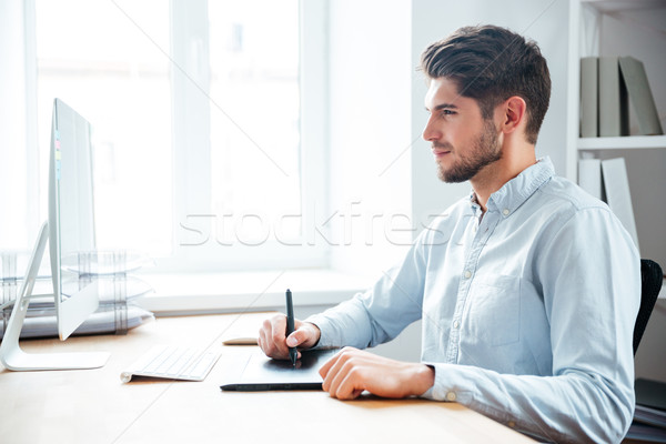 Man designer working using computer and graphic tablet in office Stock photo © deandrobot