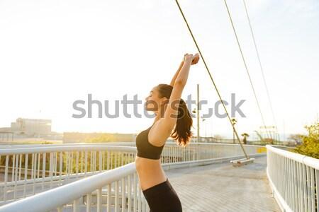 Sportsman running on pier at the sunset Stock photo © deandrobot