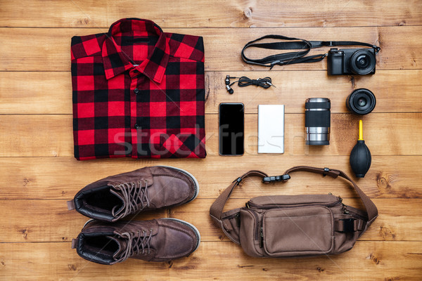 Travel concept boots, shirt, camera, mobilephone, bag, mp3, Stock photo © deandrobot