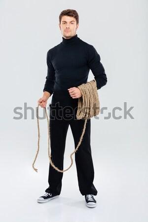 Full length of man criminal burglar standing and holding rope Stock photo © deandrobot