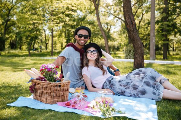 Feliz piquenique parque relaxante mulher Foto stock © deandrobot