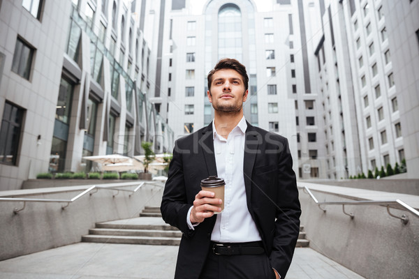 Businessman drinking take away coffee in the city Stock photo © deandrobot