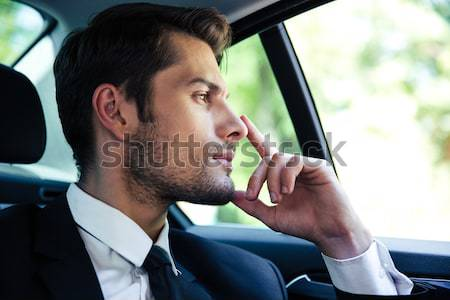 Cheerful bearded young man drinking tea. Stock photo © deandrobot