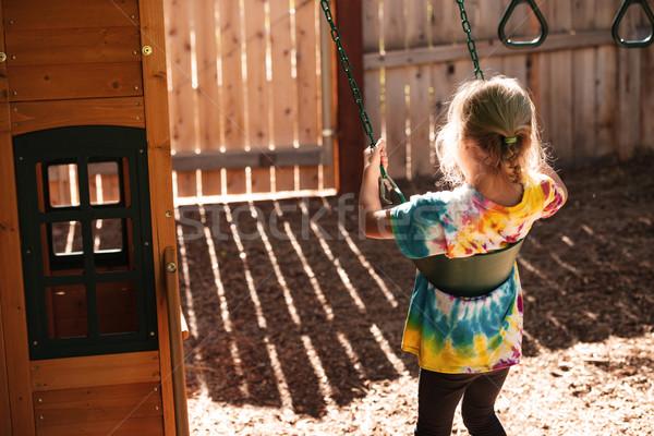 Górę widoku dziewczyna huśtawka boisko widok z tyłu Zdjęcia stock © deandrobot