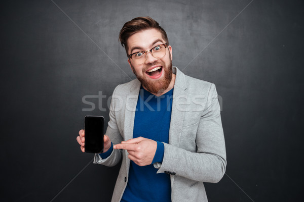 Happy hipster with phone Stock photo © deandrobot