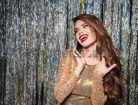 Gelukkig jonge vrouw avondkleding permanente lachend Stockfoto © deandrobot