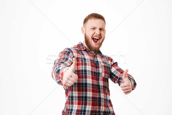 Screaming Bearded man in shirt with thumbs up Stock photo © deandrobot