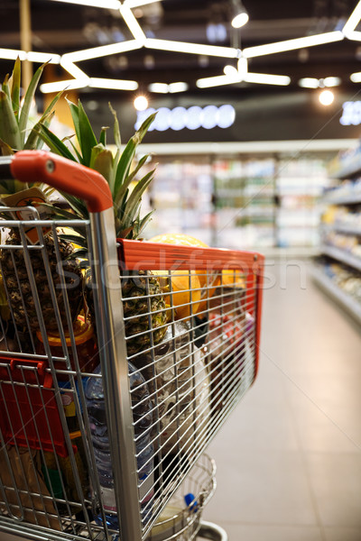 Shopping trolley in supermarket. Stock photo © deandrobot