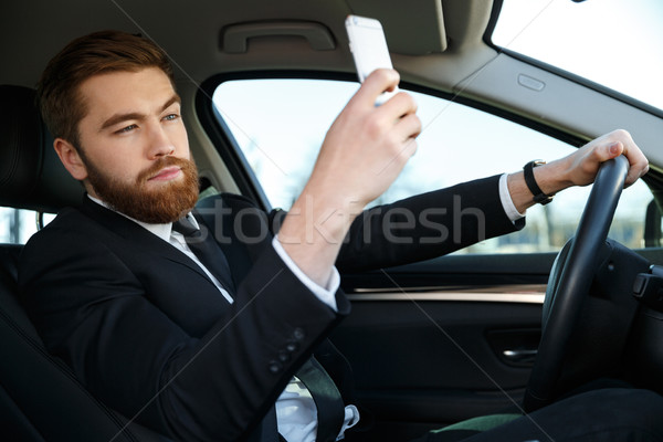 Side view of calm business man making selfie Stock photo © deandrobot