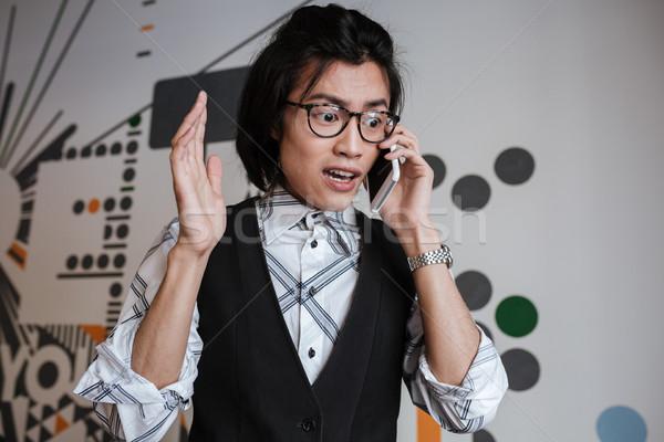 Foto stock: Jovem · asiático · homem · falante · telefone · móvel