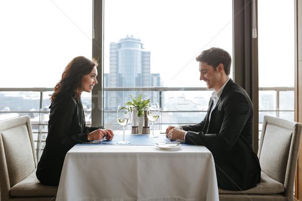 Zijaanzicht paar restaurant vergadering tabel business Stockfoto © deandrobot