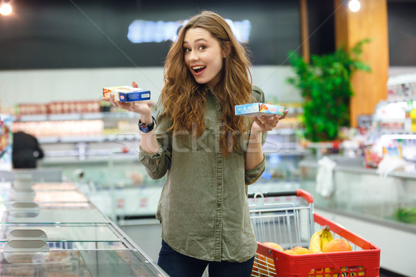 Shot of succesful choice between two products Stock photo © deandrobot