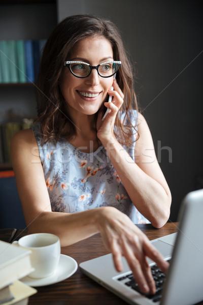 счастливым улыбаясь очки говорить телефон Сток-фото © deandrobot