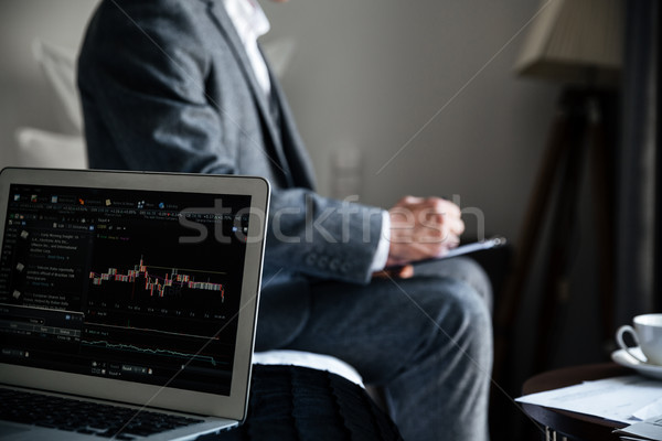 Cropped image of a businessman reviewing some documents Stock photo © deandrobot