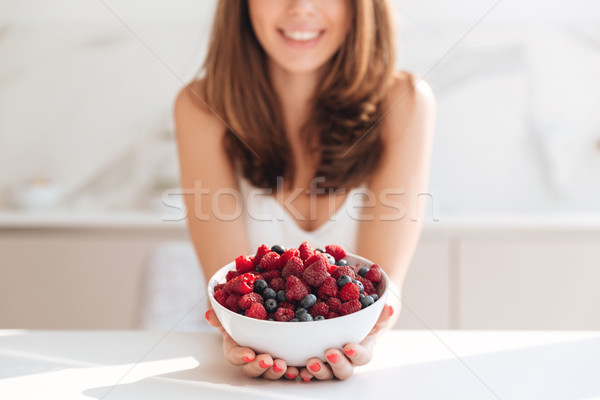 Stock photo: Close up portrait of smiling girl holding bowl