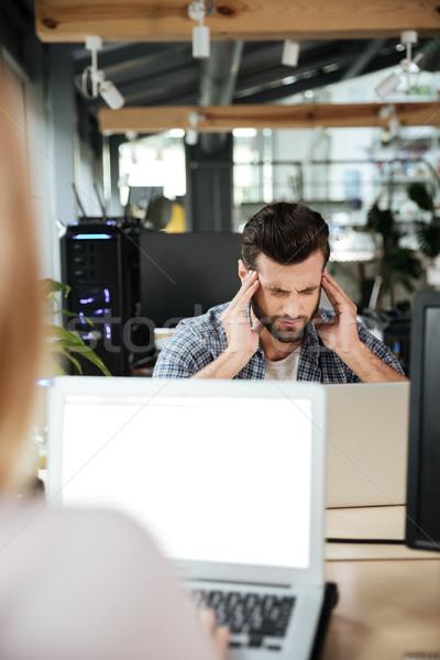 Koncentrált gondolkodik férfi iroda laptopot használ kép Stock fotó © deandrobot