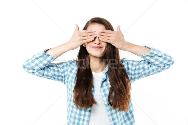 Young girl grimacing at camera isolated over white Stock photo © deandrobot