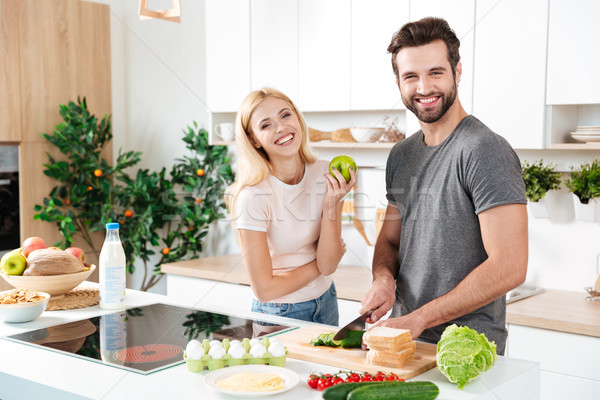 Smiling couple spending time together in the kitchen Stock photo © deandrobot