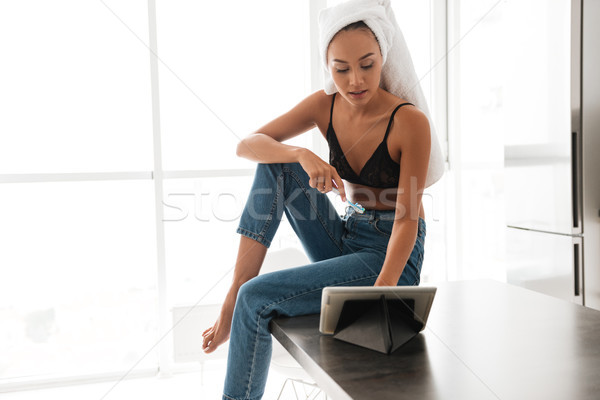 Beautiful asian woman with bath towel wrapped around her head Stock photo © deandrobot