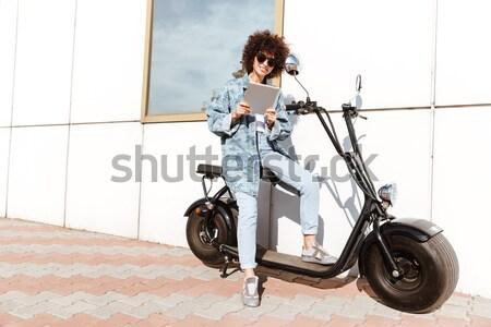 Stylish pretty woman in sunglasses posing Stock photo © deandrobot