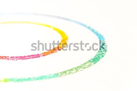 Cropped photo of two circle drawn with colorful pastel chalks Stock photo © deandrobot