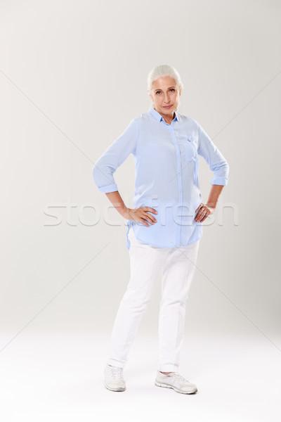 фото серьезный старший женщину Постоянный рук Сток-фото © deandrobot