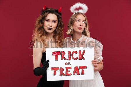 Dwa szczęśliwy krzyczeć kobiet rozmiar Zdjęcia stock © deandrobot