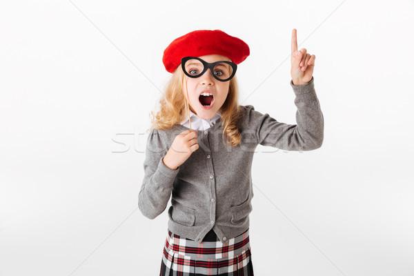 Portret opgewonden weinig schoolmeisje uniform wijzend Stockfoto © deandrobot