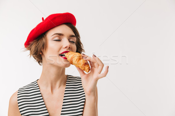 Retrato satisfeito mulher boina alimentação Foto stock © deandrobot