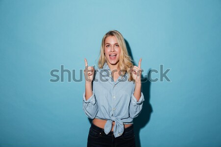 Retrato frustrado mulher rosa terno posando Foto stock © deandrobot