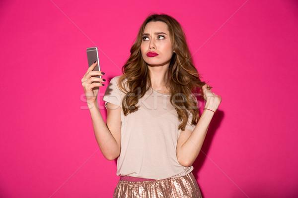 печально мышления молодые Lady телефон Сток-фото © deandrobot