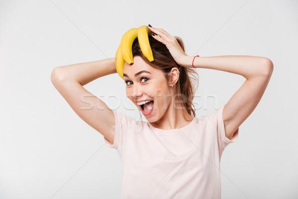 Portret vrolijk meisje bananen hoofd Stockfoto © deandrobot