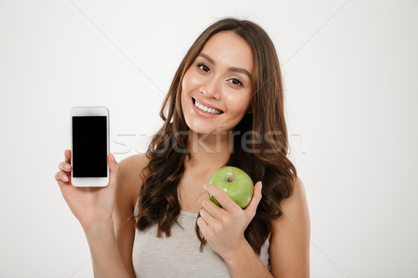 Image of beautiful woman with perfect smile demonstrating silver Stock photo © deandrobot