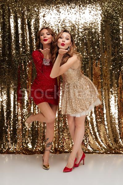 Full length portrait of two beautiful playful women Stock photo © deandrobot