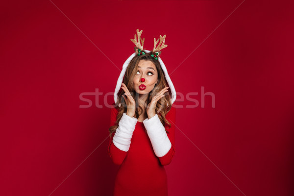 Portrait of a lovely toughtful girl Stock photo © deandrobot
