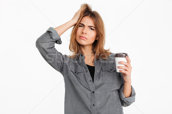 портрет недоуменный девушки чашку кофе глядя Сток-фото © deandrobot