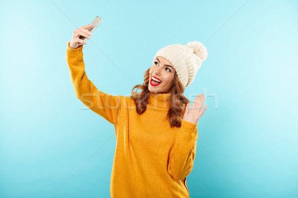 Portrait of a cheerful pretty girl in winter clothes Stock photo © deandrobot