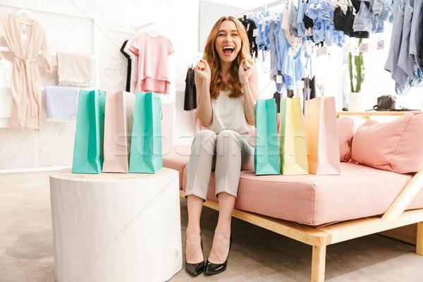 Foto stock: Excitado · sesión · ropa · tienda