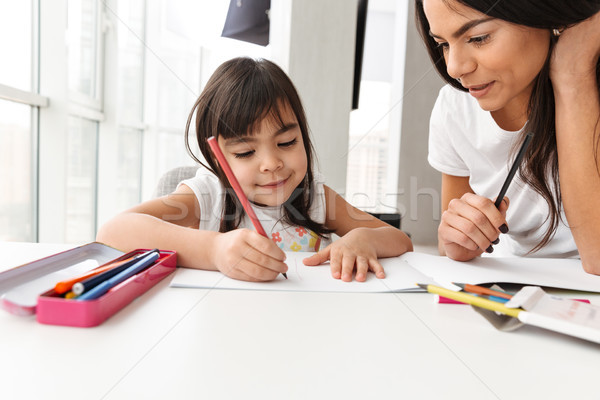 Image of satisfied people woman and child enjoying day together  Stock photo © deandrobot