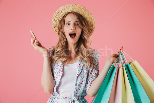Portrait of a surprised young woman in summer dress Stock photo © deandrobot