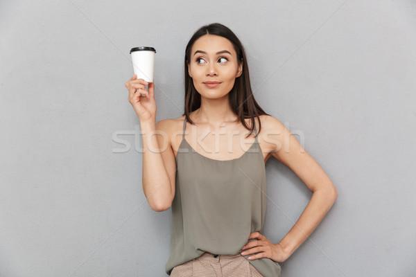 Portrait of a pretty asian woman take away coffee cup Stock photo © deandrobot