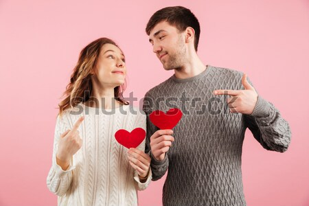 Image of happy romantic couple man and woman in denim clothing h Stock photo © deandrobot
