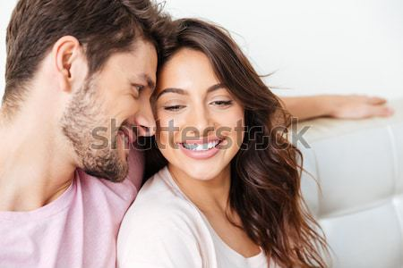 Portrait of two happy people man and woman taking selfie photo w Stock photo © deandrobot