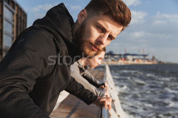 Close up of a confident fitness man warming up Stock photo © deandrobot