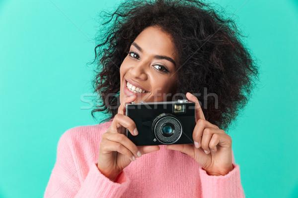 Afbeelding volwassen meisje retro camera handen Stockfoto © deandrobot